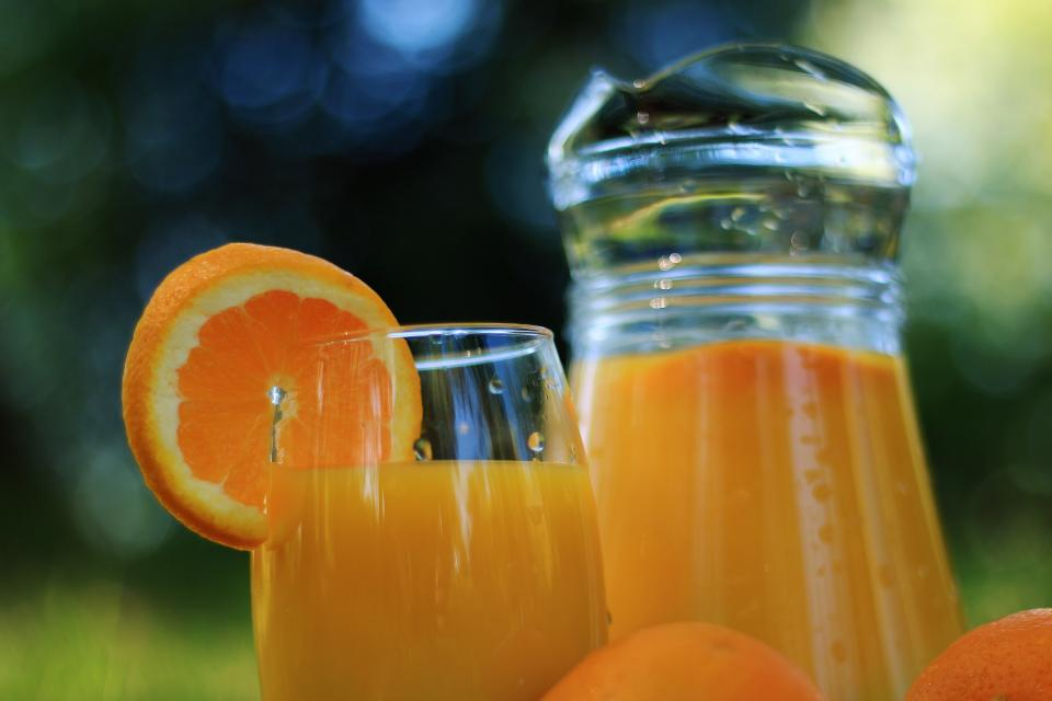 orange juice oranges glass